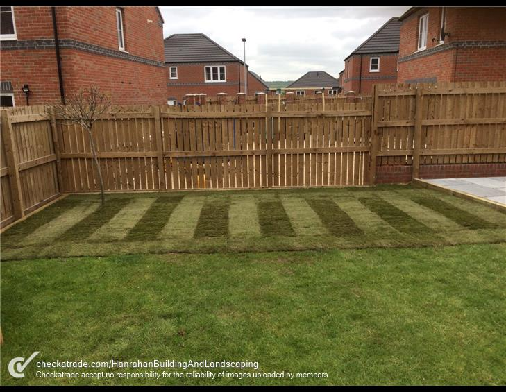 Turfing put in place at back garden of home grass