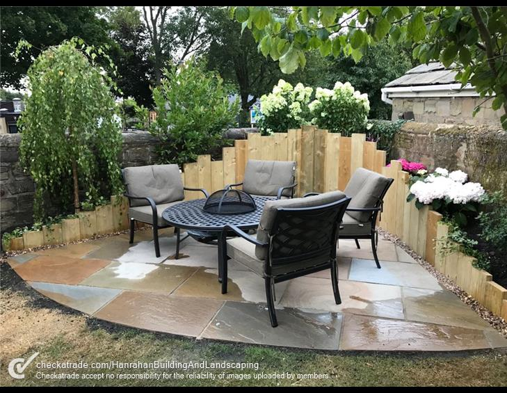 Patio space in back garden with chairs and a table