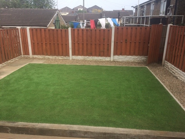 Artificial grass in back garden completed with fencing