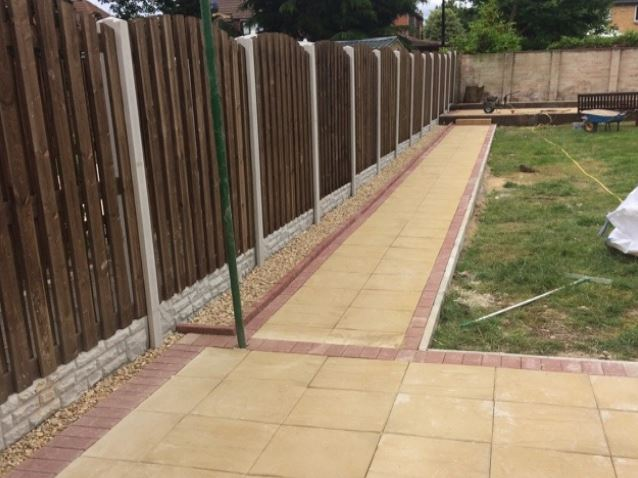 Completed fencing project with slabs in garden