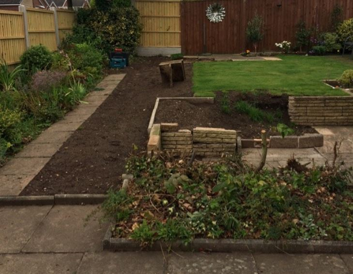 Landscaping project before completion garden with grass