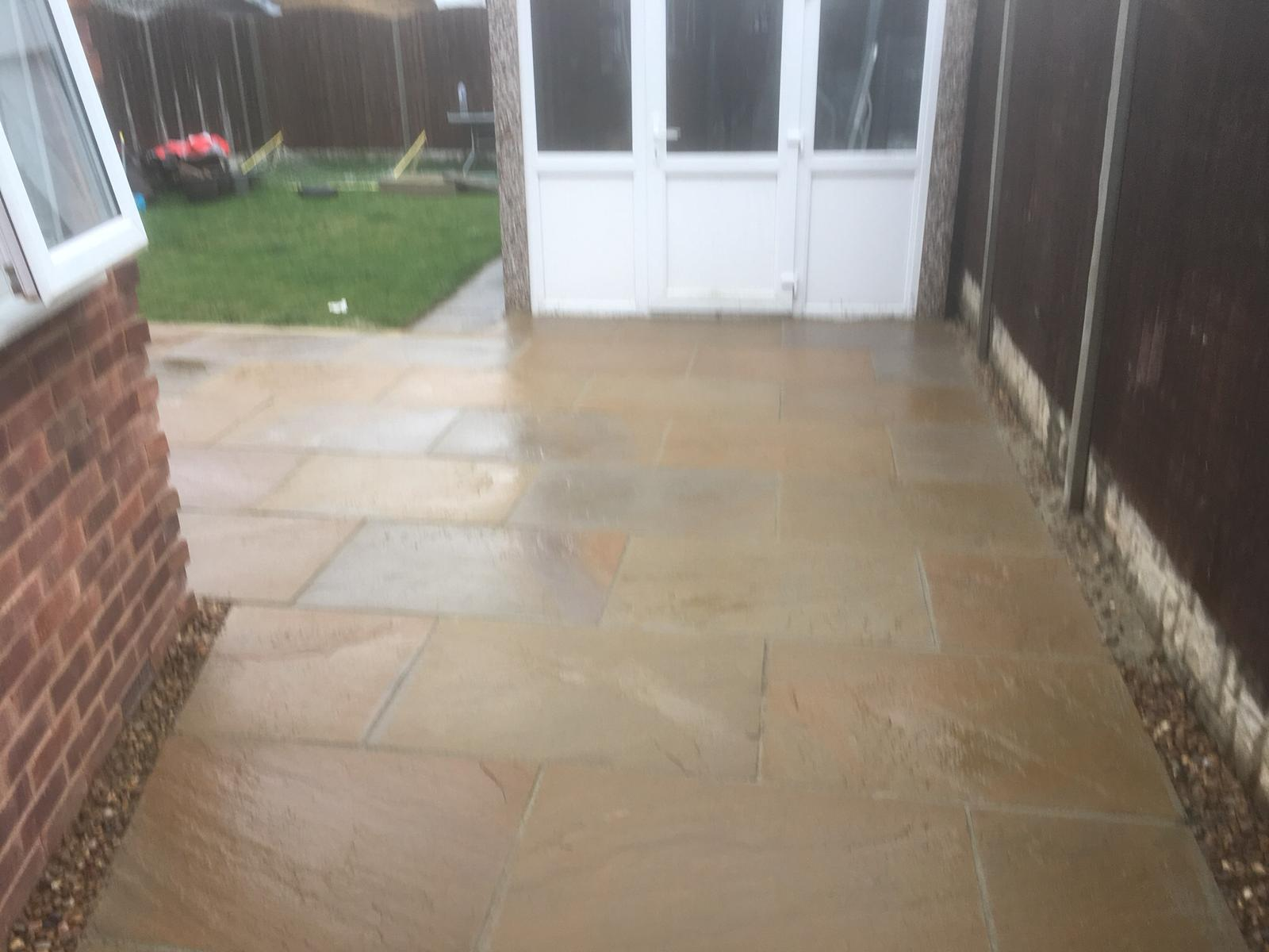 Patio space back of house in garden slabs