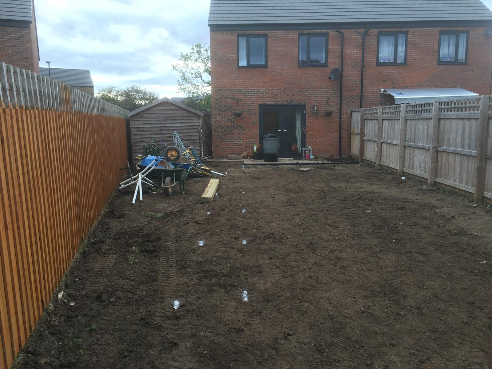 Back garden artificial grass project before