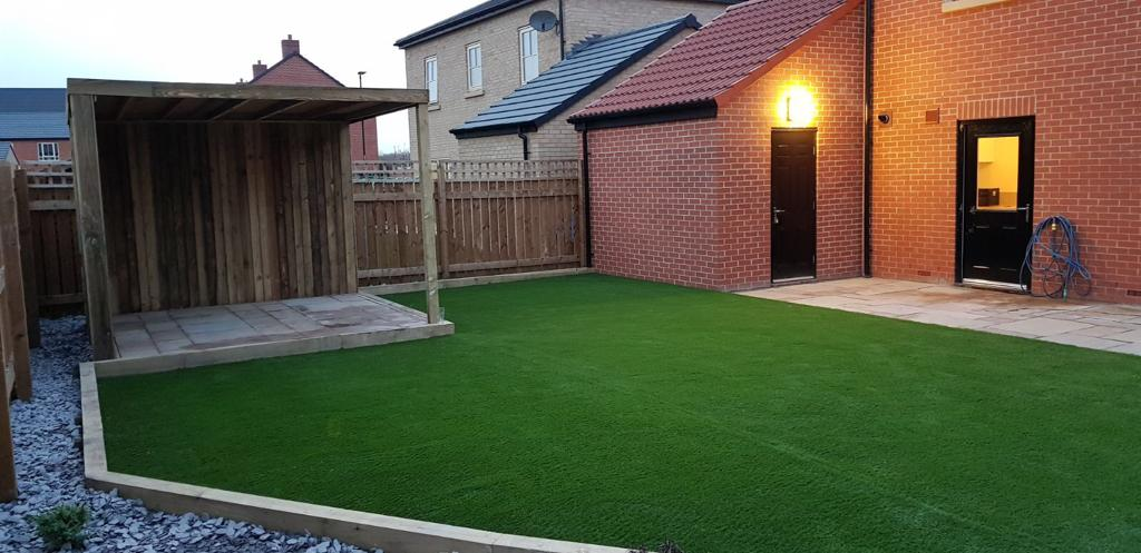 Artificial grass and fencing in garden